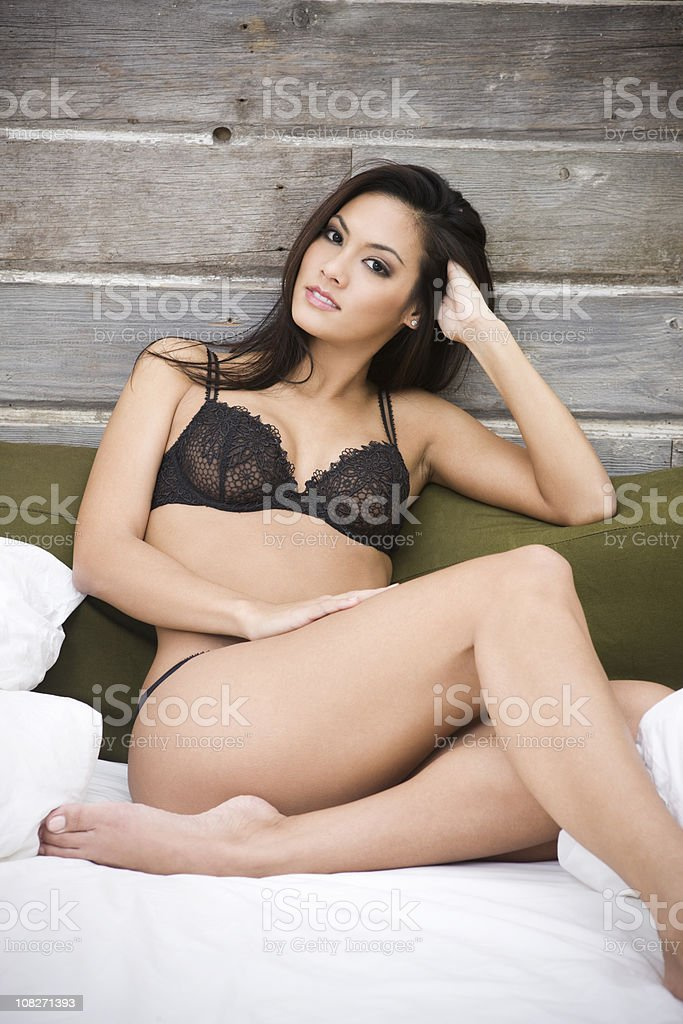 Beautiful Sexy Woman in Black Lingerie at Loft Bed, Copyspace stock photo