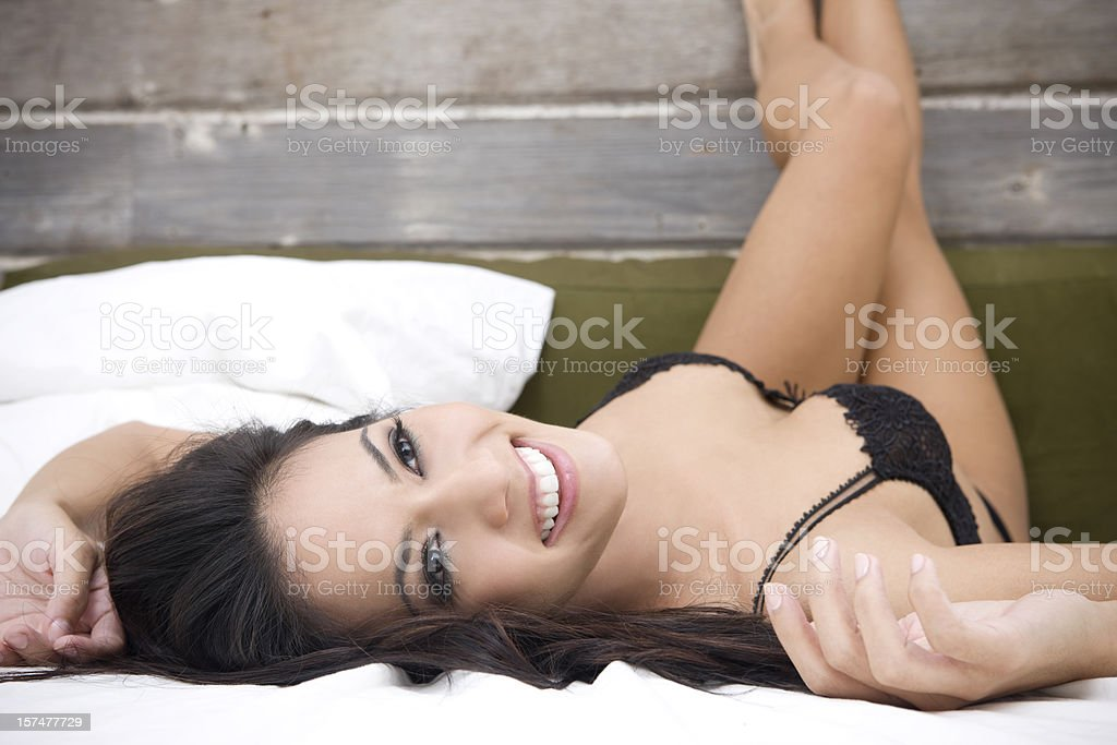 Beautiful Sexy Woman in Black Lingerie at Loft Bed, Copyspace royalty-free stock photo