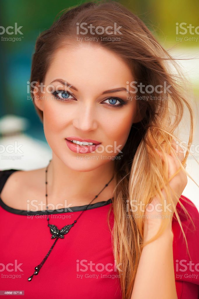 5fa9f4785fa Beautiful Sexy Woman In Red Dress And Blond Hair Outdoor Stock Photo ...
