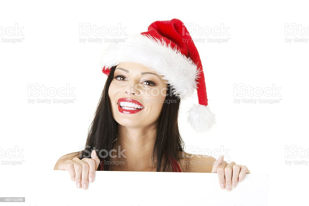 ec453e129c6dd Beautiful sexy woman in red swimsuit and santa hat. royalty-free stock photo