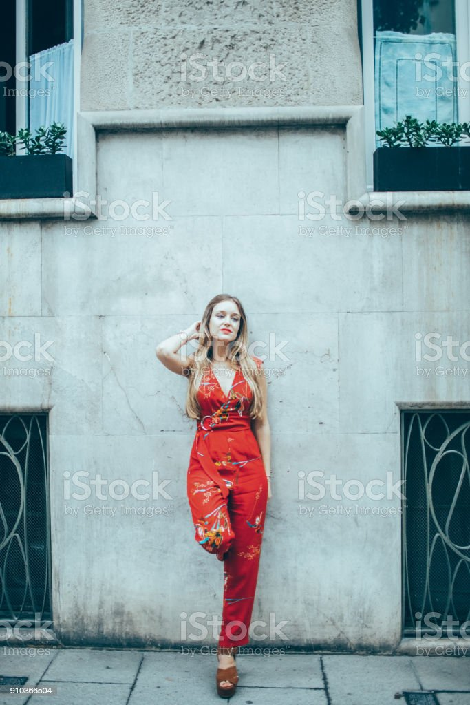 Beautiful Sexy Woman Leaning on Wall in City stock photo