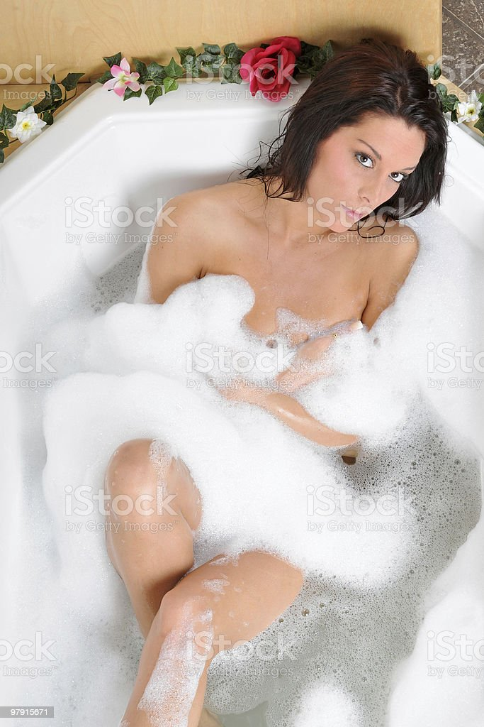 Beautiful sexy woman taking a bubble bath royalty-free stock photo