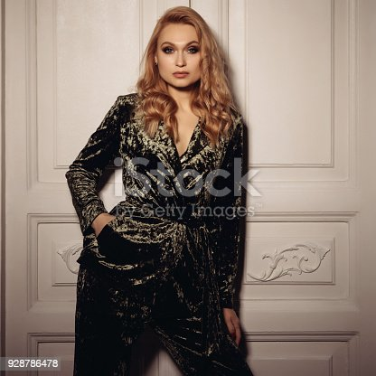 Beautiful sexy woman wear velvet suit clothes for businesswoman office style is standing near the door