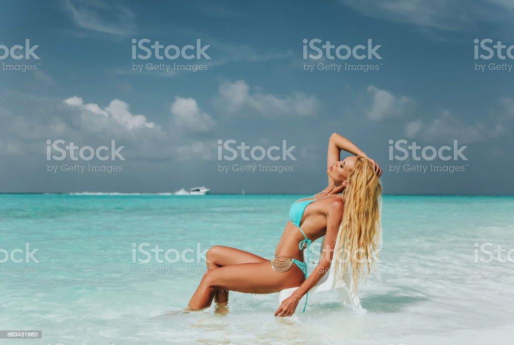 beautiful sexy woman with blond hair in fashion swimming suit relaxing on Maldives - Zbiór zdjęć royalty-free (Bikini)