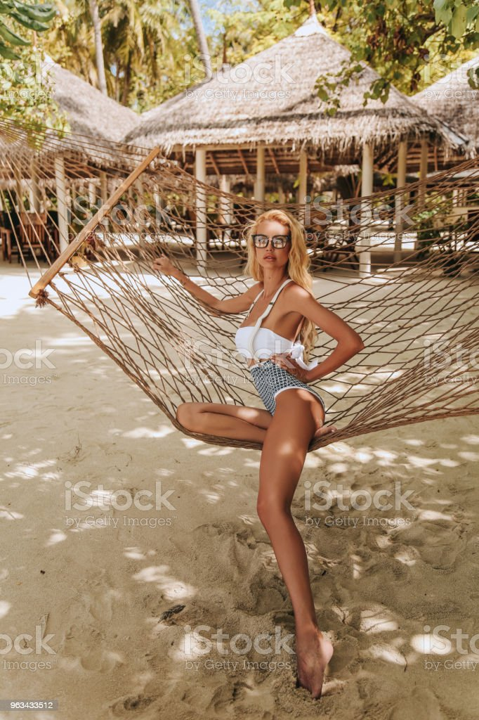 beautiful sexy woman with blond hair in fashion swimming suit relaxing on Maldives - Zbiór zdjęć royalty-free (Bikini)