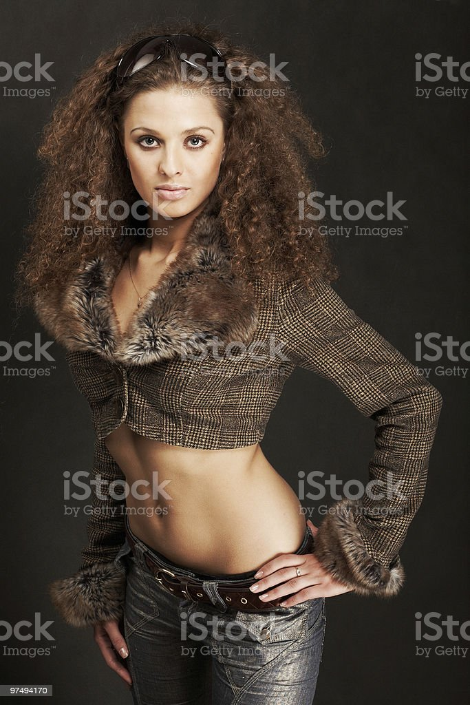 Beautiful sexy woman with long curly hair royalty-free stock photo