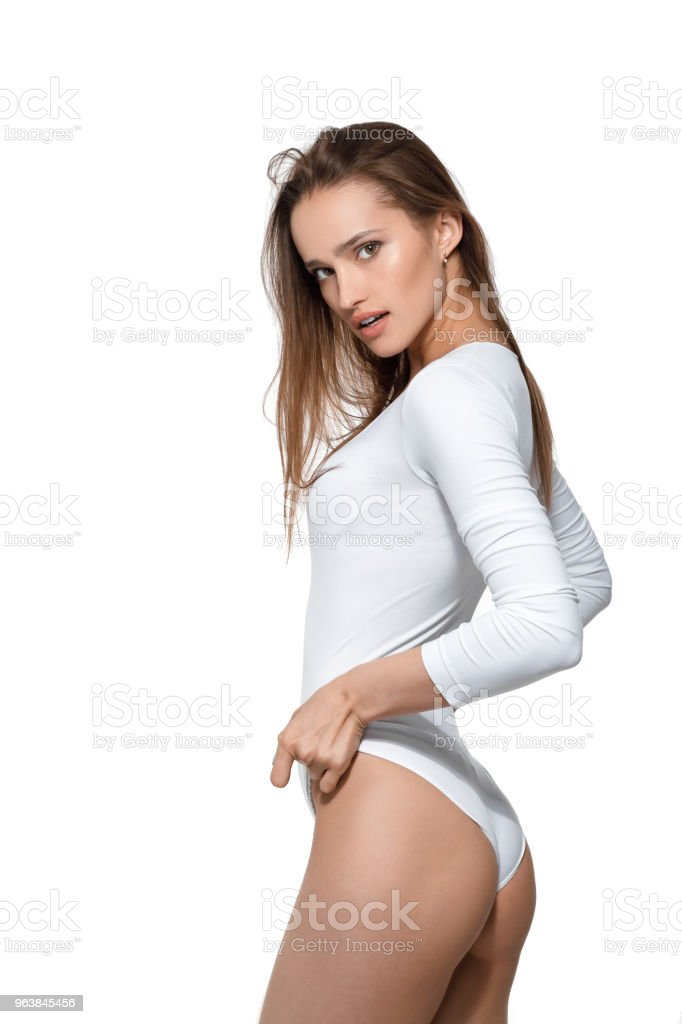 beautiful sexy woman with perfect body in white bodysuit - Royalty-free Adult Stock Photo