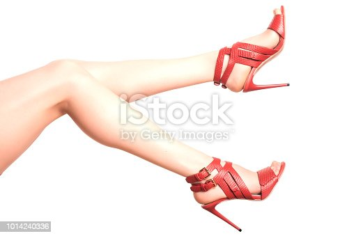 Beautiful, sexy, women's legs in red shoes on a white background.
