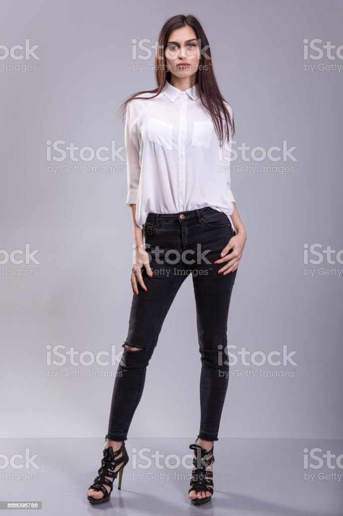7ceb8457afba44 Beautiful sexy young business woman brunette hair wearing white skirt and  black pants high heels shoes