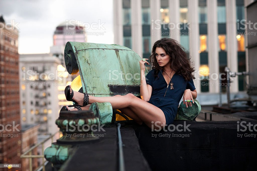 Beautiful, Sexy Young Woman Fashion Model on Downtown Rooftop, Copyspace royalty-free stock photo