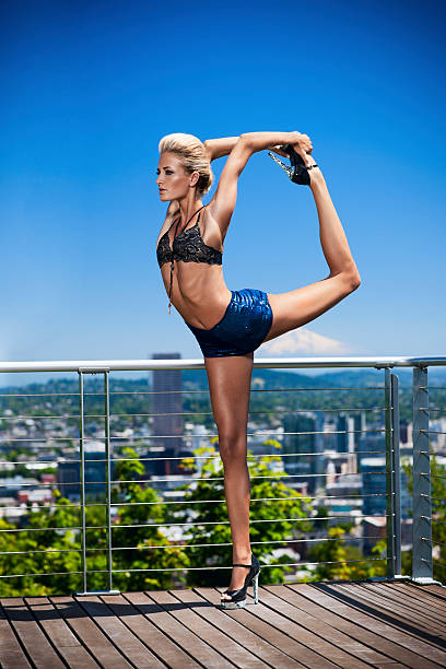 Beautiful, Sexy Young Woman in Fashion Yoga Pose Outdoors, Copyspace stock photo