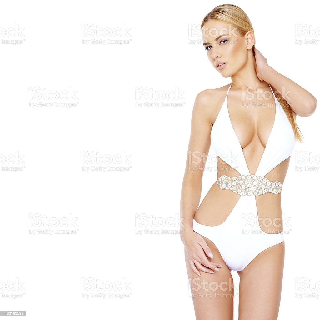Beautiful shapely woman in a white swimsuit royalty-free stock photo