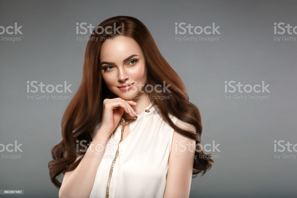 Beautiful shine hair woman with manicure nails hand. Brunette with...