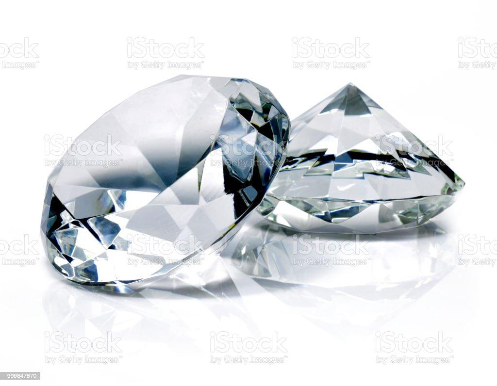 Beautiful shiny diamonds, isolated on white background stock photo
