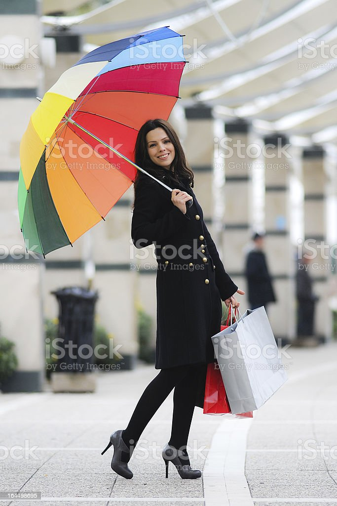 beautiful shopper with her umbrella royalty-free stock photo