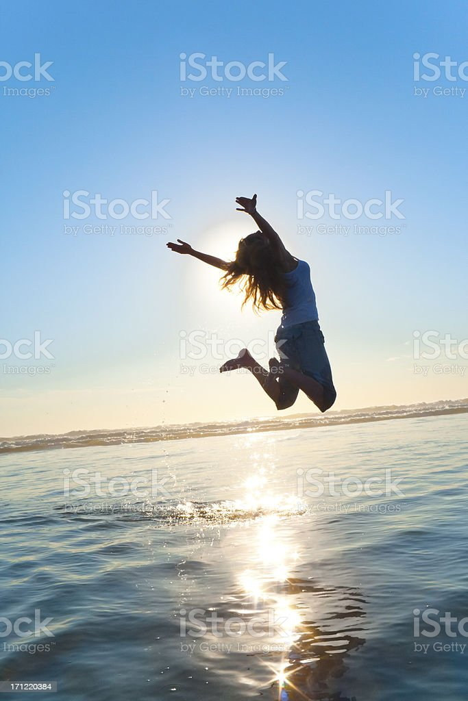 Beautiful Silhouette of Jumping Girl stock photo