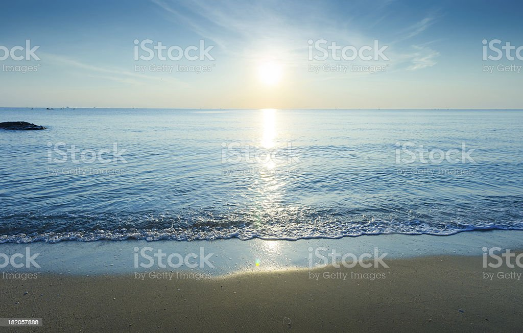 Beautiful silhouette sunset at the tropical beach stock photo