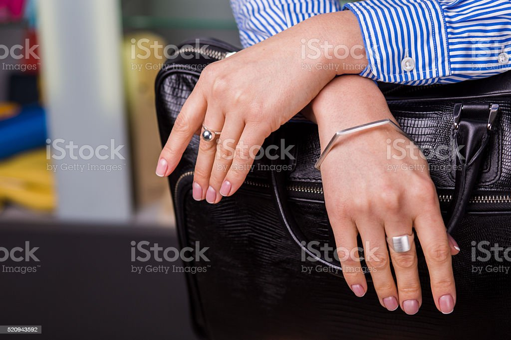 Beautiful silver jewelry on women's hands close up. stock photo