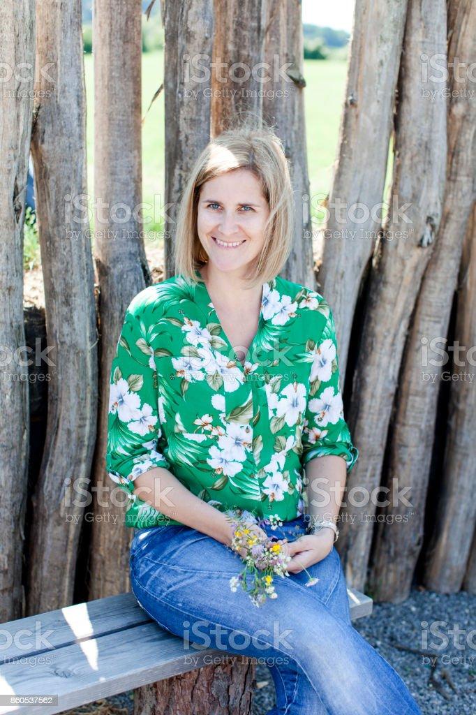 beautiful sitting happy woman stock photo