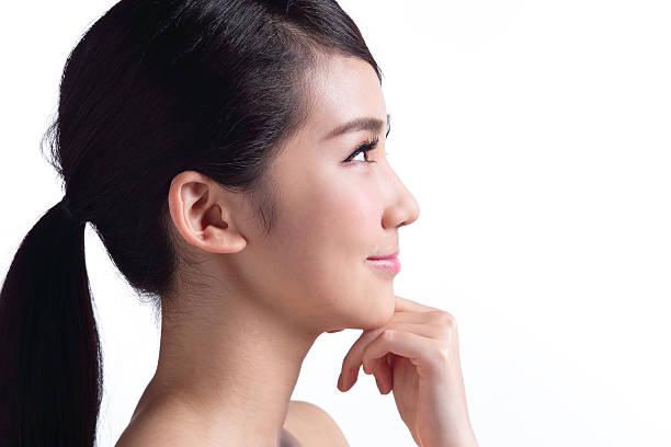 美しいスキンケア女性の顔 - 女性 横顔 日本人 ストックフォトと画像