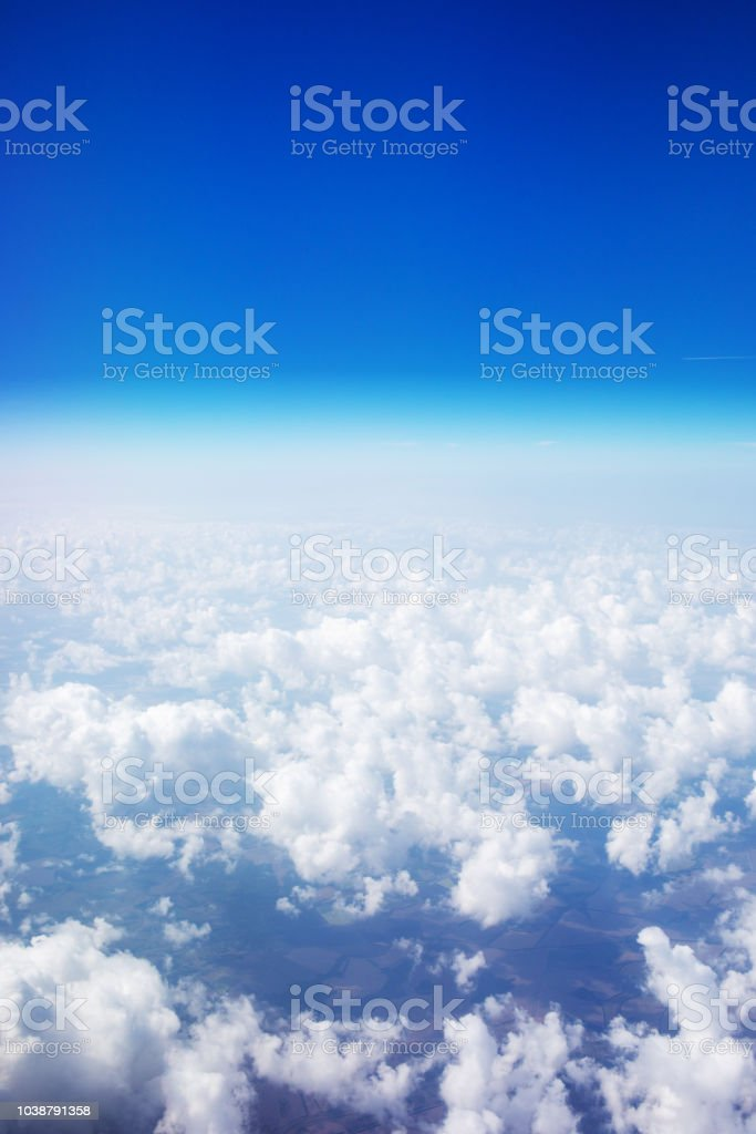 Beautiful Sky above the clouds. View from the airplane window with...