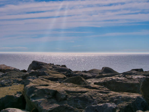 Beautiful sky reflection and foggy sea and  big rocks stock photo
