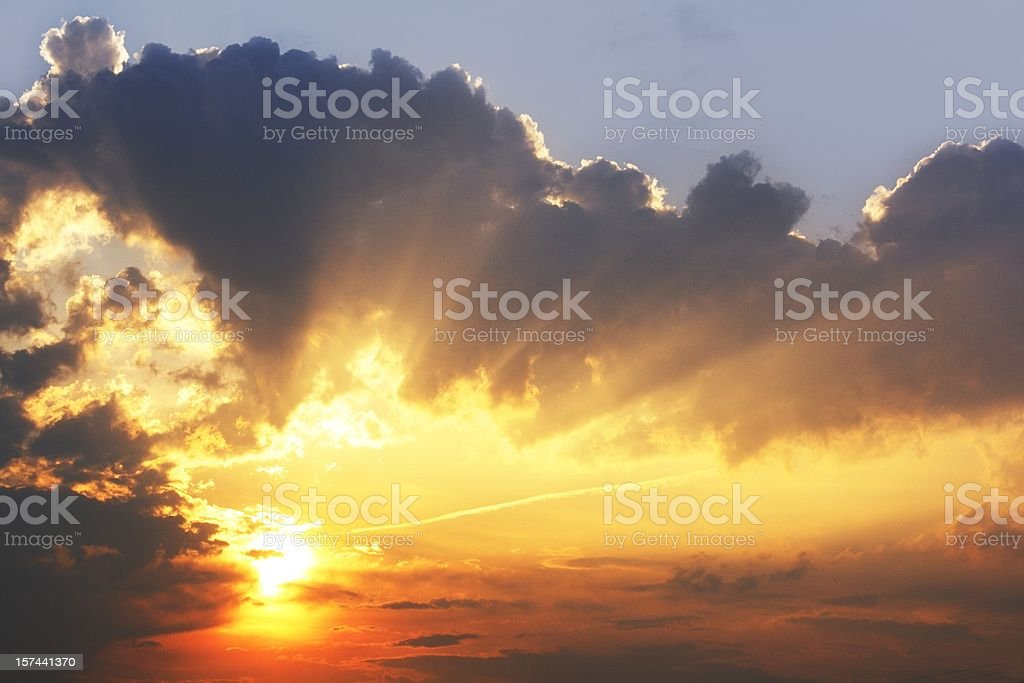 beautiful sky sunrise with sunbeams in dark clouds wallpaper stock photo