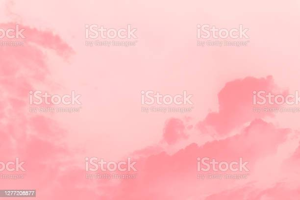 Photo of Beautiful sky with cirrocumulus clouds, pink coral watercolor toned