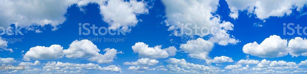 Beautiful sky with white fleecy clouds stock photo