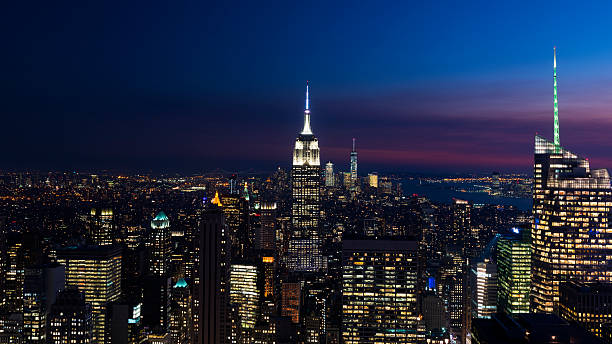 beautiful skyline of new york city at twilight - night stock photos and pictures