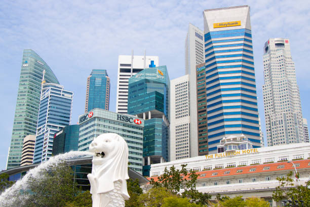 Beautiful skyline with Merlion in Singapor This is a picture of great scenery with skyscrapers and Merlion. merlion fictional character stock pictures, royalty-free photos & images