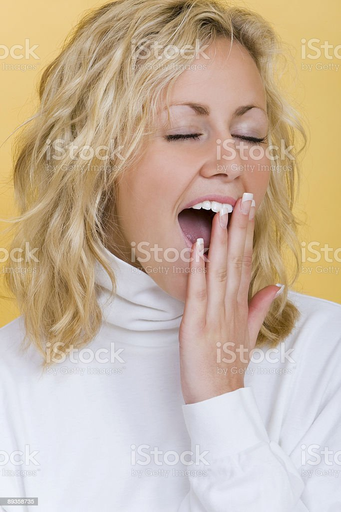 Beautiful Sleepy Young Blond Woman Yawning royalty-free stock photo