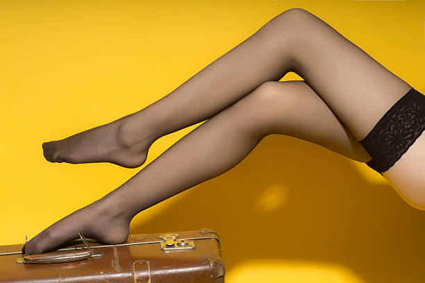 beautiful slender female legs and suitcase - black women wearing pantyhose stock photos and pictures