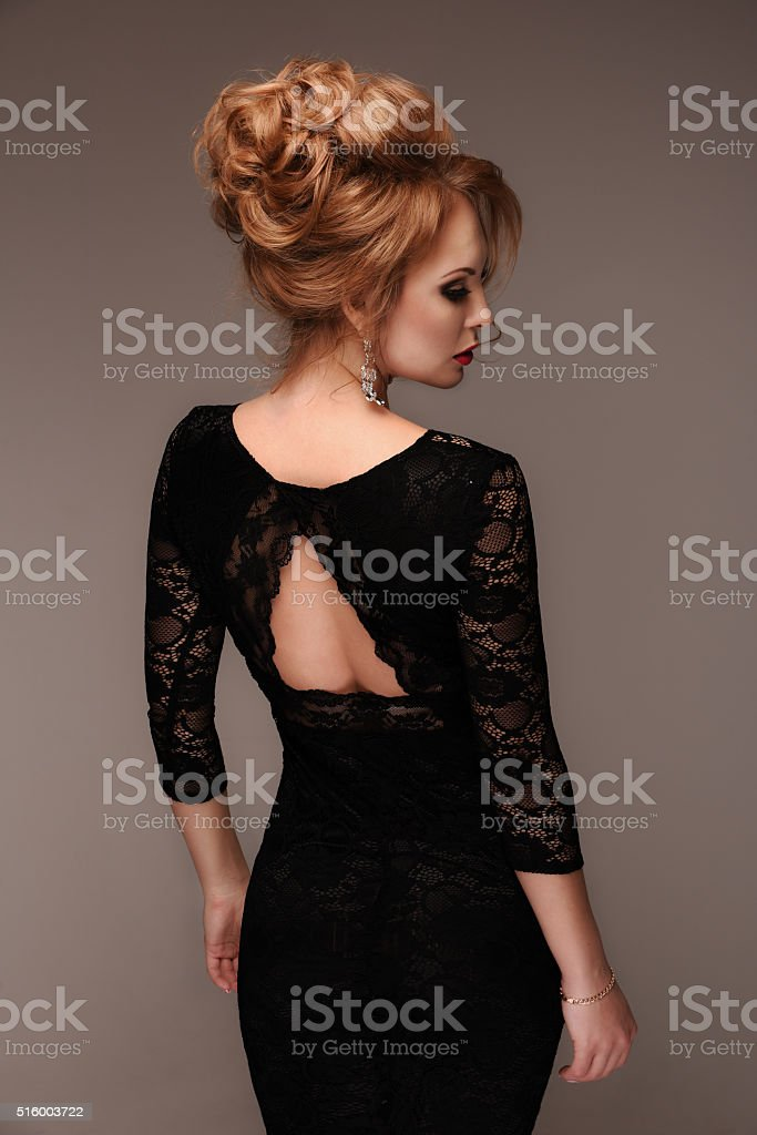 Beautiful slender woman in a black lace dress stock photo
