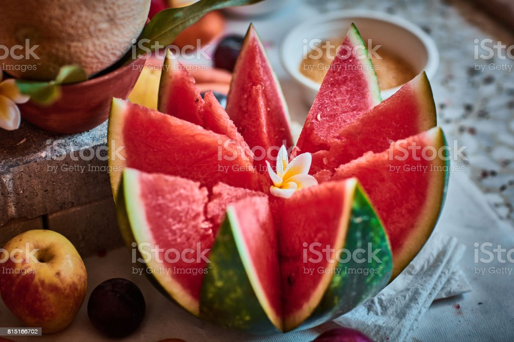 Beautiful sliced fruits arranged with blurred background stock photo
