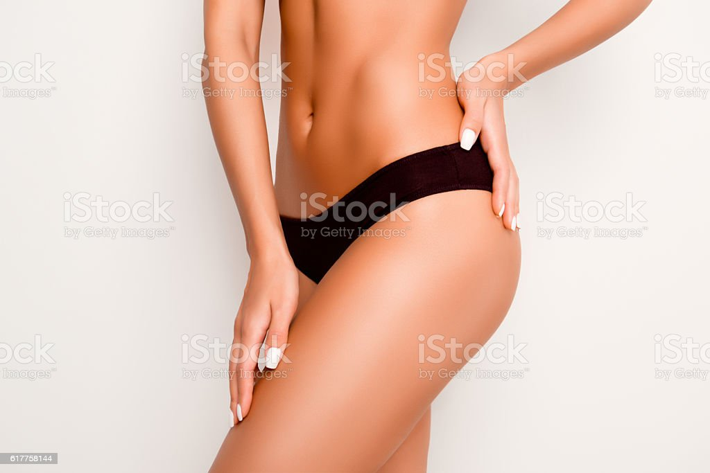 Beautiful slim woman body with tan isolated on white background stock photo