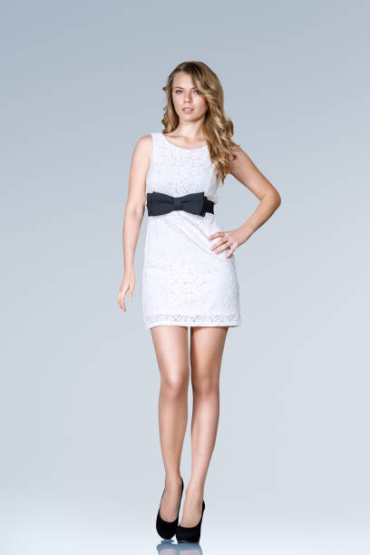 beautiful slim woman in mini dress - mini dress stock photos and pictures