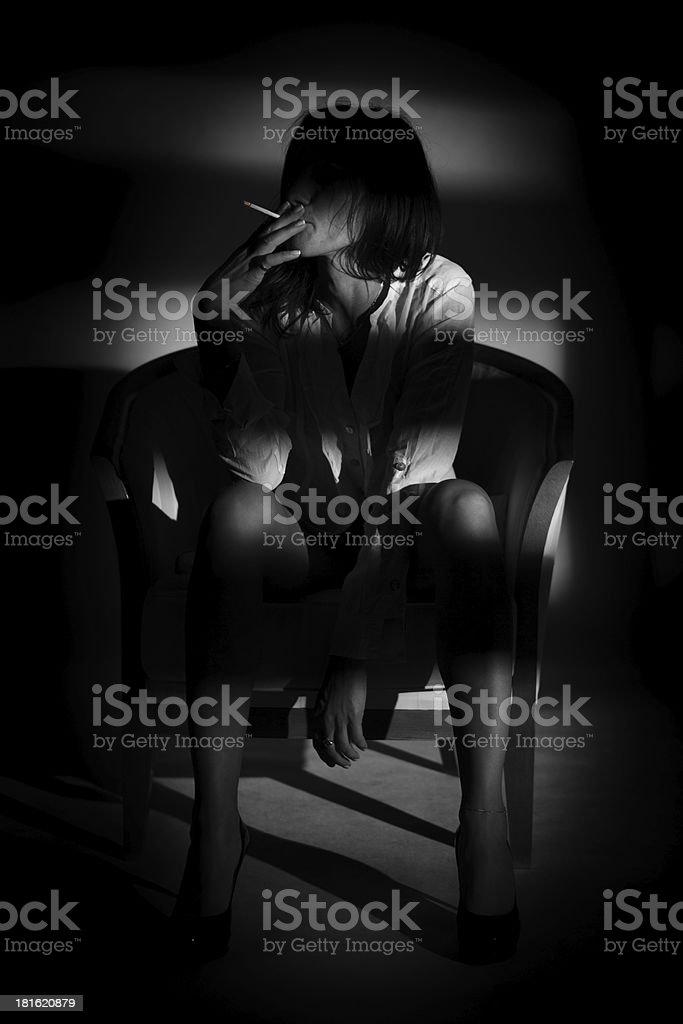 Beautiful slim woman smoking cigarette stock photo