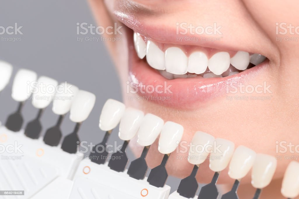 Beautiful smile and white teeth of a young woman. stock photo