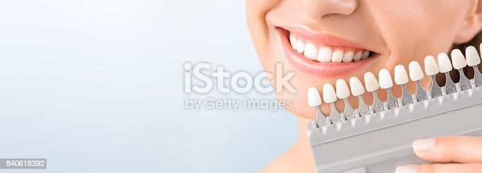 istock Beautiful smile and white teeth of a young woman. 840618392