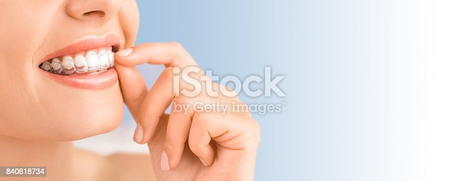 istock Beautiful smile and white teeth of a young woman. 840618734