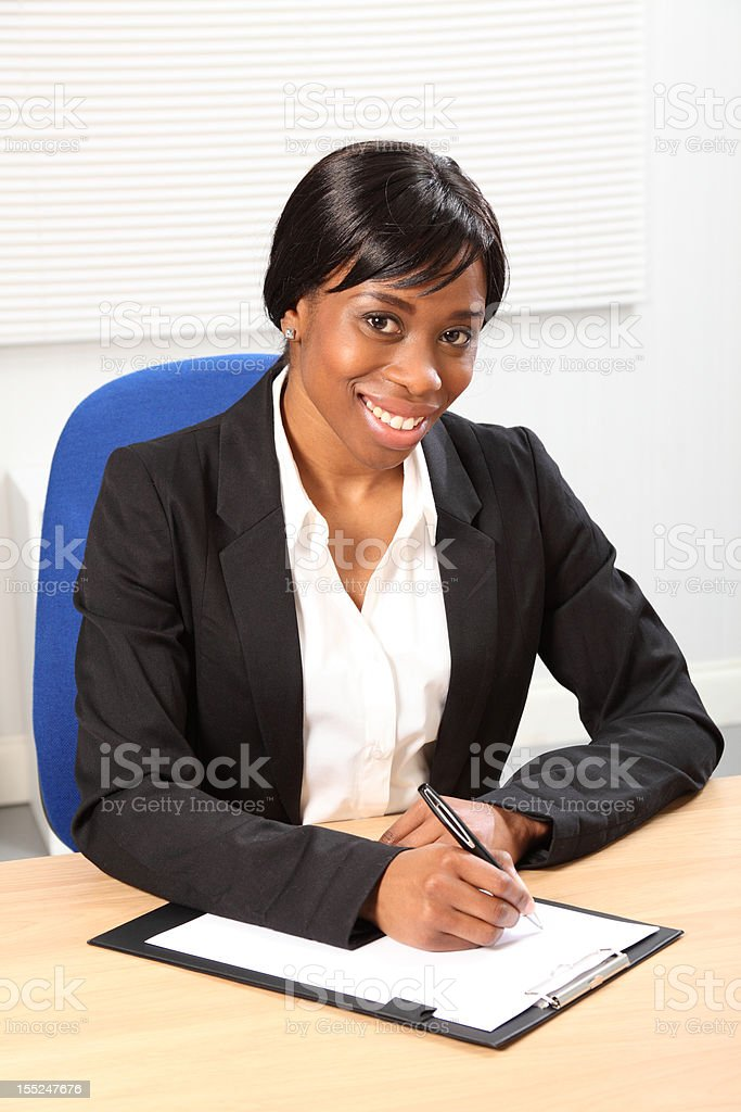 Beautiful smile by black woman in business office royalty-free stock photo
