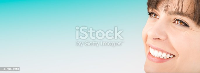 istock Beautiful smile young woman. White teeth on the master plan. 667846380
