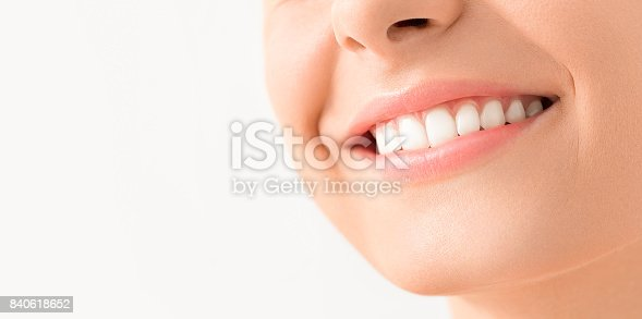 istock Beautiful smile young woman. White teeth on the master plan. 840618652