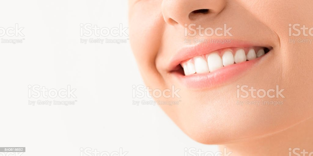 Beautiful smile young woman. White teeth on the master plan. stock photo