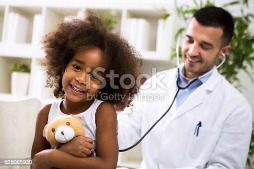 istock Beautiful smiling afro-american girl with her pediatrician 528065930