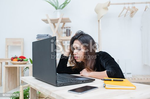 485539628 istock photo Beautiful smiling Asian student woman learning from online education service, Young Asian woman looking computer laptop confuse about her business work 920000928