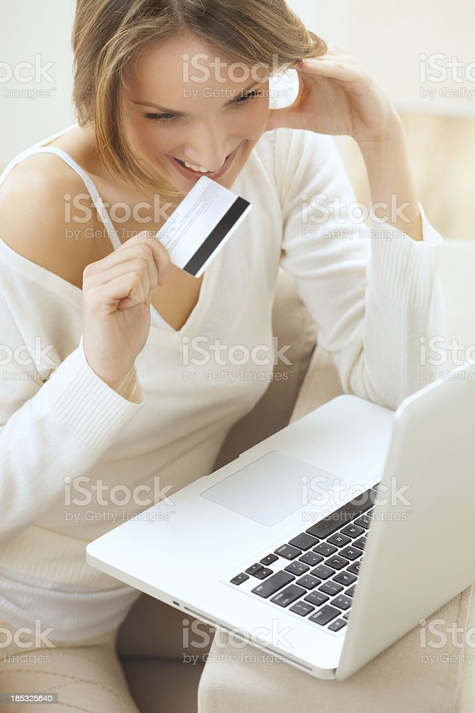 Beautiful smiling blond woman, shopping online from home royalty-free stock photo