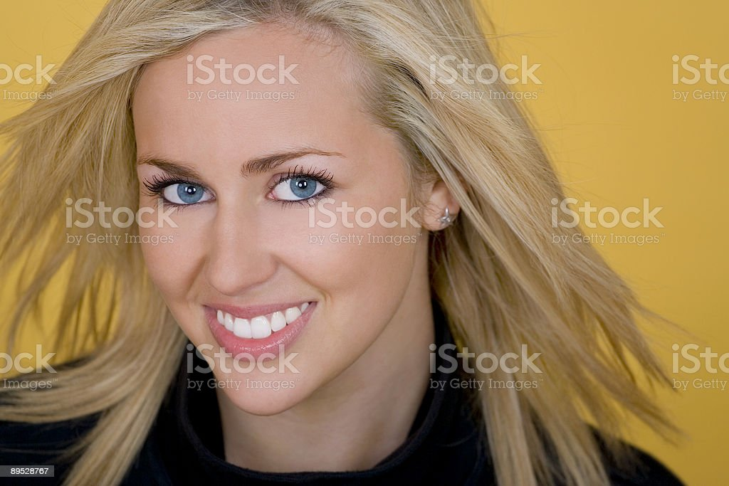 Beautiful Smiling Blond Woman With Perfect Teeth and Blue Eyes royalty-free stock photo