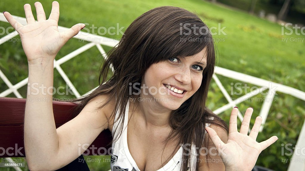Beautiful smiling brunette girl with open palms royalty-free stock photo
